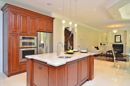Kitchen cabinets with stained maple wood doors