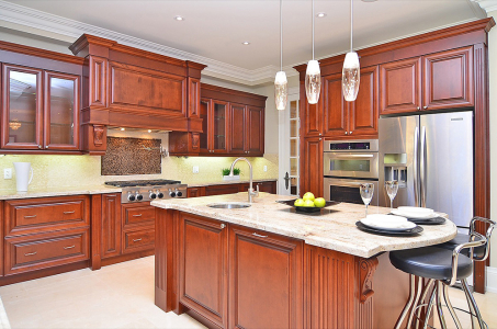 Maple wood Classic Kitchen with custom hood cabinets and posts